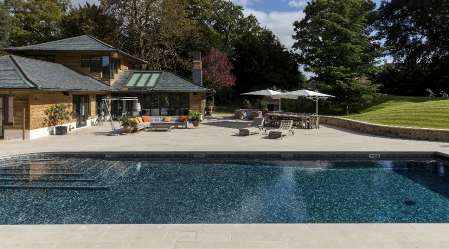 Bespoke stone patio and swimming pool surround for private summer house