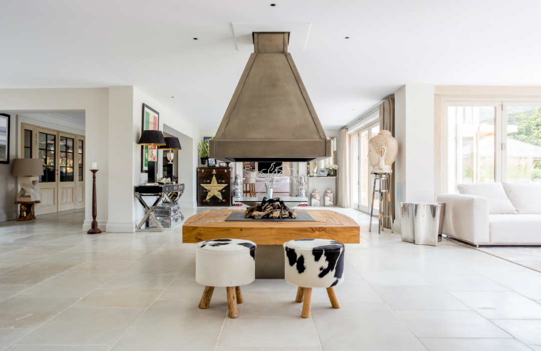 Open fire with fur stools and Lulworth Limestone flooring