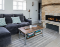 Cosy sitting room with navy sofas and fireplace