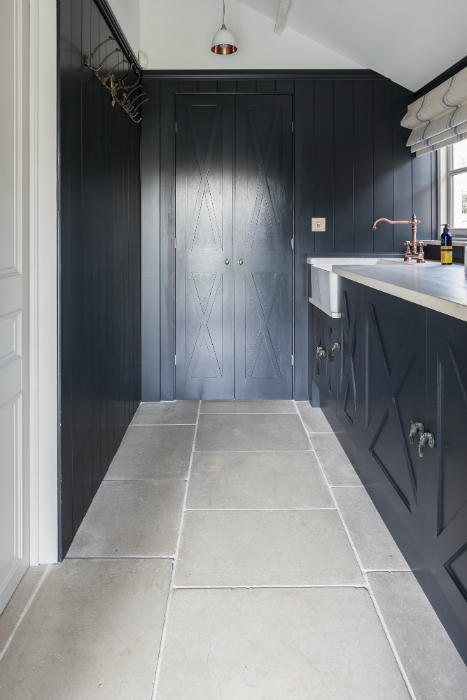 Dark utility with Farrow & Ball painted walls and beautiful stone flooring