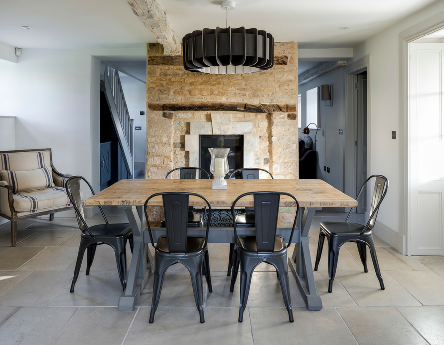 Contemporary cottage dining room with feature fireplace