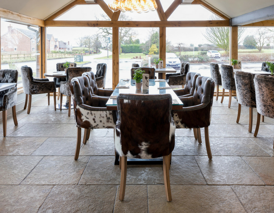 Contemporary restaurant with faux fur chairs